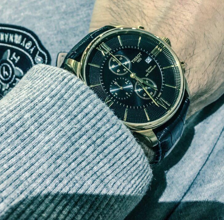 man wearing tissot watch