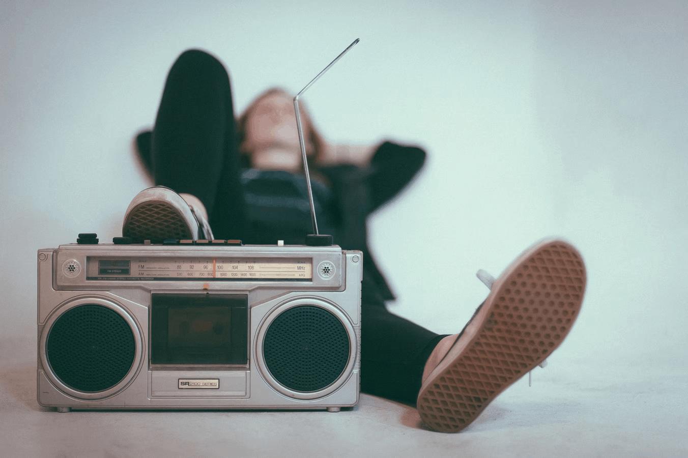 person listening to radio
