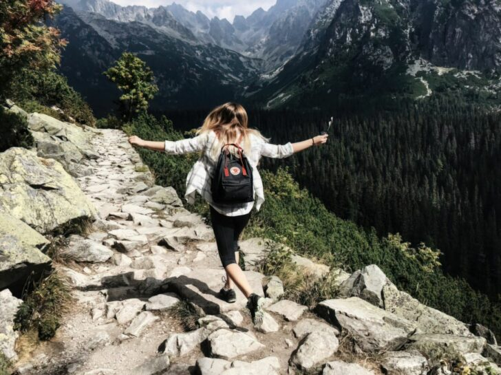 woman skipping down the mountain