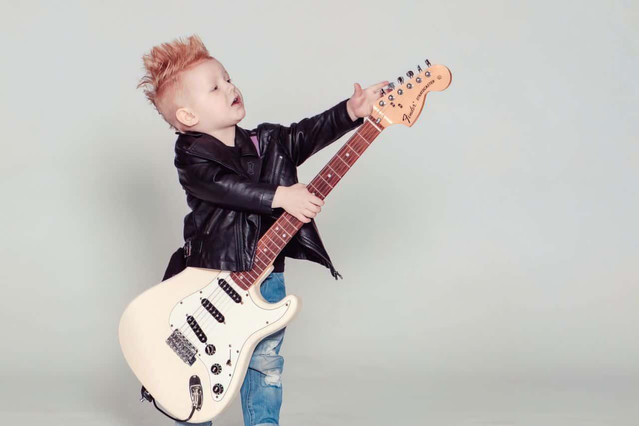 child holding guitar