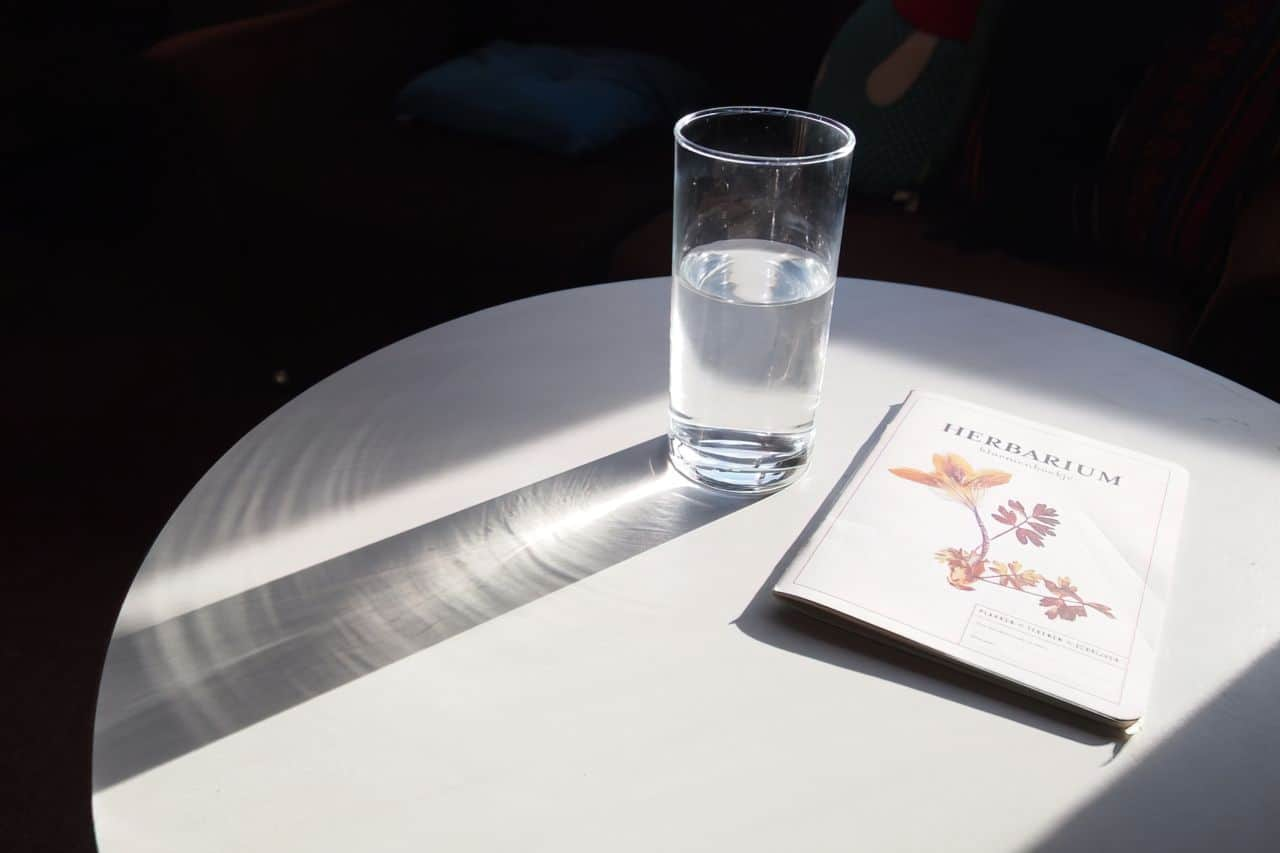 glass of virgin water on a table